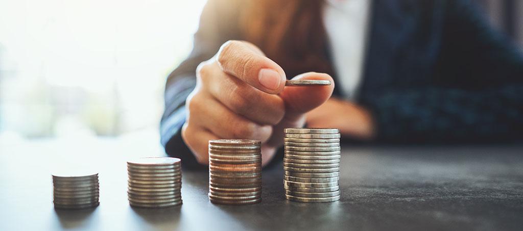 Münzenstapel als Zeichen für steigende Immobilienpreise