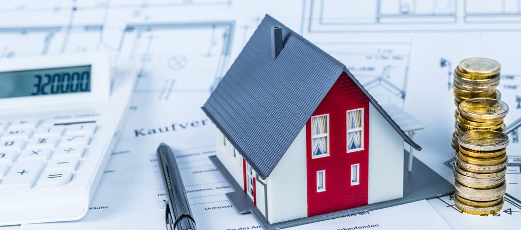 Modellhaus als Symbolbild für Nebenkosten beim Kauf einer Immobilie
